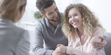 Happy couple in therapy with Marriage therapist