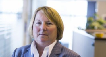 Image and headshot of Dr. Ellen Mandinach.