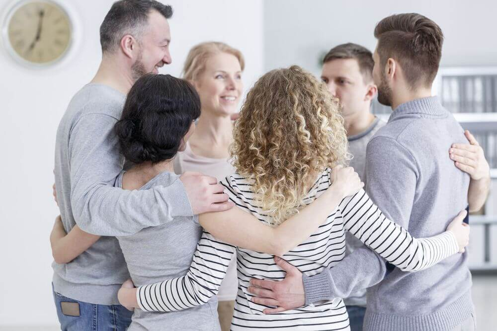 Bachelor's Psychology Students Hugging After a Practice Session