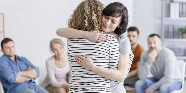 Women Hugging In Group Therapy