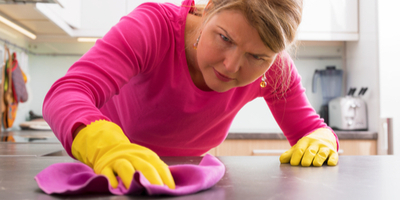 Concerned woman cleaning a counter